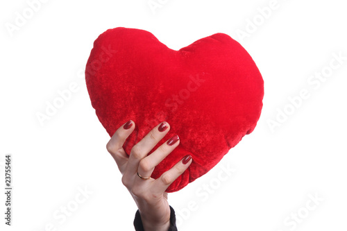 beautiful woman holding a love symbol in hands