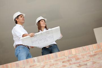 Architects holding blueprints