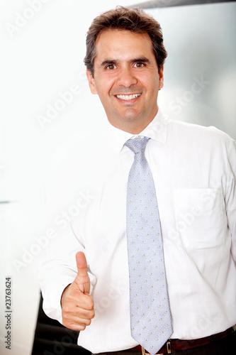 Business man with thumbs up