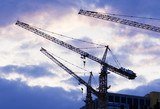 Building with elevating crane and clouds on background poster