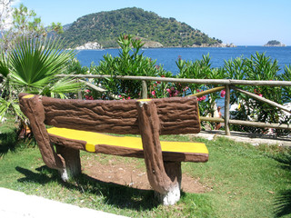 bench in park with sea view
