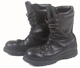 black military leather boots on white background