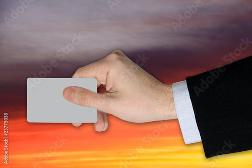 Businessman´s  Hand with blank credit Card on dramatically Sky