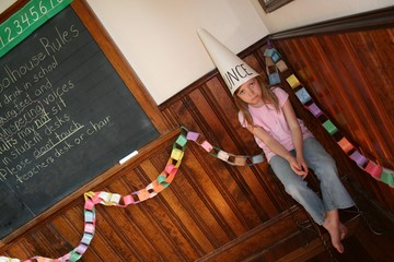 Diagonal version of girl in corner with dunce cap