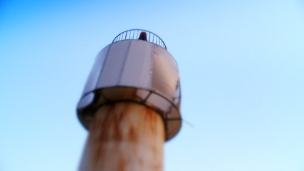 Old lighthouse and blue sky. HD 1080p, Selective focus.