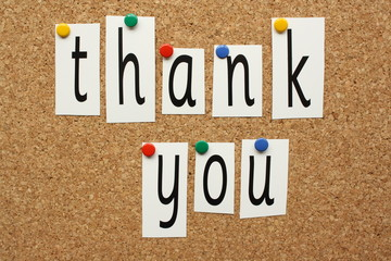 Thank You in letters pinned to a cork board