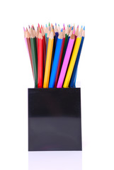 Coloured pencils in desk tidy