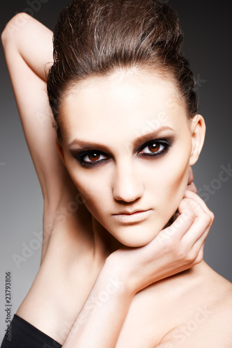 Fashion woman with dark evening smoky make-up in model pose