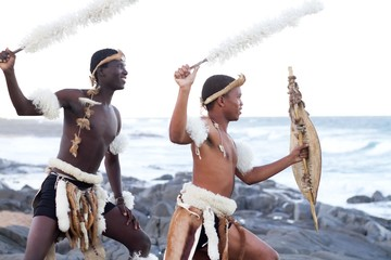 african traditional men on beach