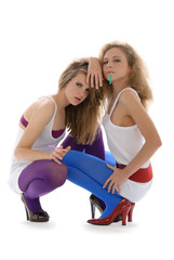 Two young beautiful women with cigarettes