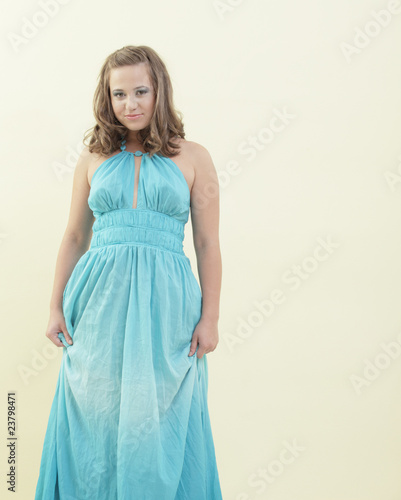 Attractive woman in a blue dress