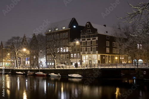 Amsterdam canals and typical houses on a snowy winters night