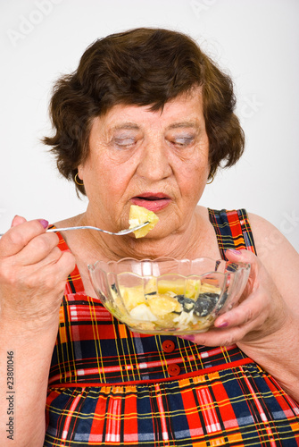 Senior eating  potato salad
