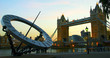 Tower Bridge and sun dial at dusk, London