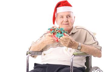 eldery man in wheelchair celebrating christmas