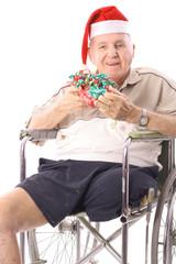 eldery man in wheelchair celebrating christmas vertical
