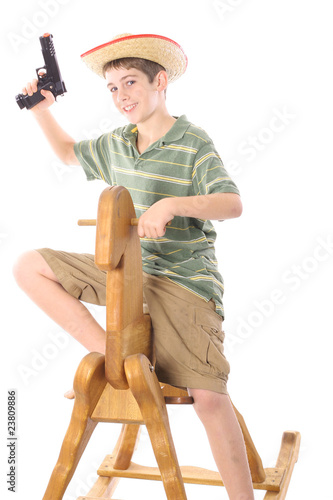 young boy playing cowboy