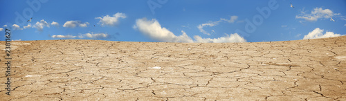 A background image of dried and cracked soil - 23811627