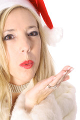 gorgeous santa woman blowing kiss angle