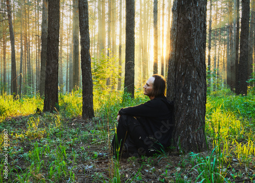 man in the woods at sunset