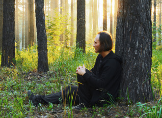 man in the forest at sunset