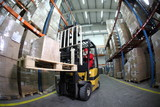 Fototapety forklift operator at work in warehouse