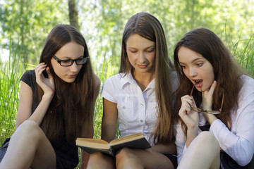 three students learning together outdoor