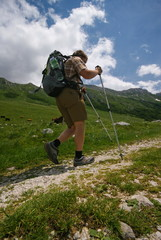 man hiking in summer alps