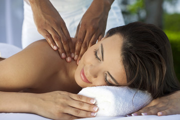 Woman Outside At Health Spa Having Relaxing Massage