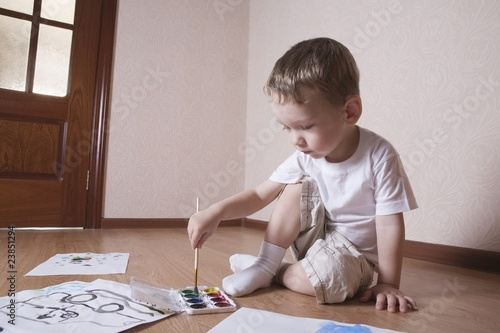 Young boy mixes paints