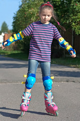 girl riding on roller blades on summer holidays