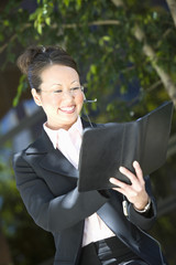 Young business woman with diary  outdoors