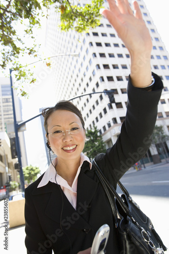 Businesswoman Waving at street