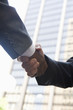Close-up of businessmen handshake  outdoors