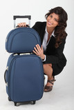 Young woman with luggages on white background