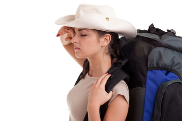 tired female tourist in hat with rucksack