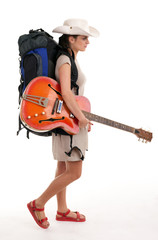female tourist with backpack and electric guitar