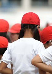 a girl wearing a red cap