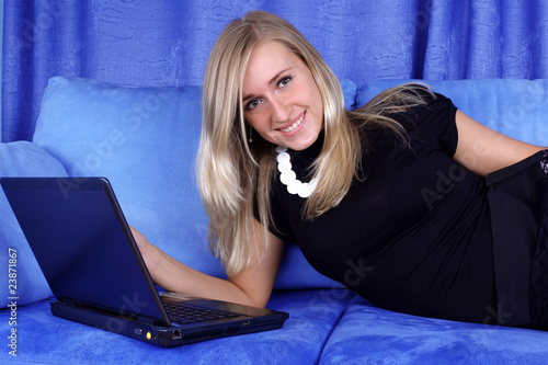 woman working with PC at home in sofa