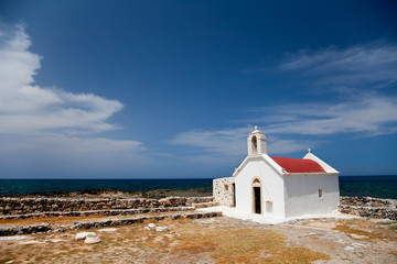Greek Crete coastline with church and cliffs