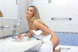 undressing woman in bathroom poster