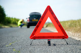Fototapety Red warning triangle with a broken down car