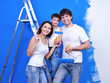 Happy family doing renovation