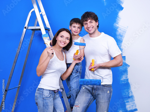 Happy family doing renovation