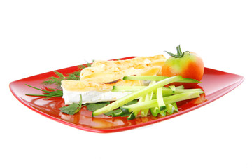 cheese cannelloni on red plate
