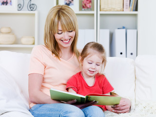 Mother with daughter reading the book