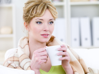 Woman with easy smile drinking