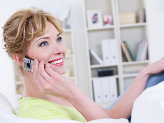 Woman with mobile speaking