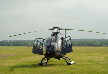 EC-120 helicopter on the grass airfield