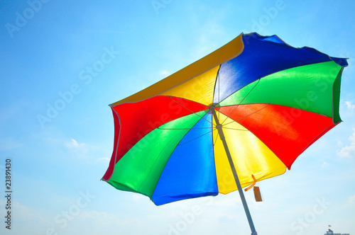 colorful beach umbrella with blue sky